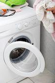 Woman do washing in a washing machine