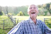 Smiling senior authentic man