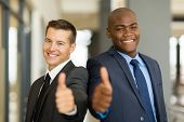 portrait of handsome multiracial business men thumbs up