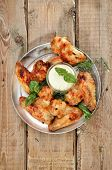 Fried Chicken Wings With Sauce On Rustic Table