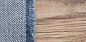 blue jean texture on wood texture background