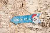 pic of north-pole  - Direction sign to North Pole on rustic wooden background - JPG