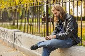 picture of long beard  - Blond long hair and beard young adult hipster man listening music - JPG