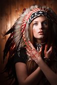 Girl with traditional Indian style hat. Indian make up art