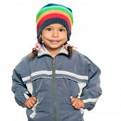 picture of beanie hat  - Multiracial small girl wearing a jacket and a colorful beanie hat isolated on white - JPG
