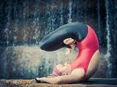 pic of padmasana  - Woman practicing yoga near waterfall - JPG