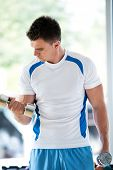picture of light weight  - young man in fintess sport club exercise with weights and relaxing - JPG
