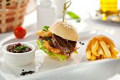 foto of fried onion  - Sandwich with Beef and Deep Fried Onions Ring - JPG