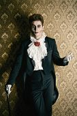 stock photo of fascinator  - Portrait of a handsome male vampire over vintage background - JPG