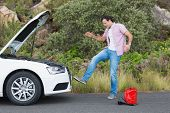 stock photo of nervous breakdown  - Angry man after a car breakdown at the side of the road - JPG