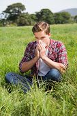 image of blowing nose  - Handsome hipster blowing his nose on a sunny day - JPG