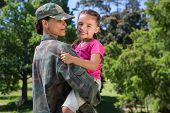 foto of reunited  - Soldier reunited with her daughter on a sunny day - JPG