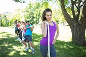 pic of tug-of-war  - Fitness group playing tug of war on a sunny day - JPG