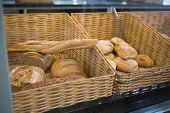 image of tong  - Baskets with breads freshly baked and tongs at the bakery - JPG