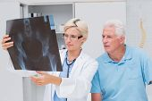 pic of medical examination  - Female doctor and senior patient examining x - JPG
