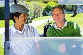 pic of buggy  - Golfing friends driving in their golf buggy at the golf course - JPG