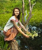 pic of undine  - girl in traditional clothes with flowers at river - JPG