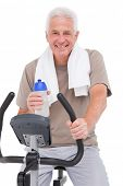 picture of exercise bike  - Senior man on exercise bike on white background - JPG