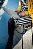 pic of bench  - Young woman writer working with laptop on the wooden bench