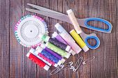 stock photo of rayon  - color threads and scissors on the wooden table - JPG