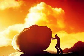 image of rocking  - Man pushing a giant - JPG