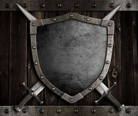 foto of shield  - medieval knight shield and crossed swords on wooden gate - JPG
