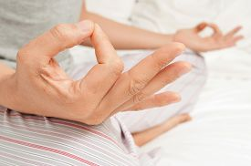 picture of mudra  - young man meditating with his hands in gyan mudra - JPG