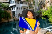 pic of cave woman  - Woman with Bosnian flag in Blagaj village - JPG