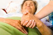 Caring Nurse Holding Hands poster