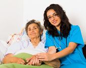 image of nurse  - Happy joyful nurses caring for kind elderly patients helping their days in nursing home - JPG