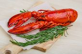 pic of lobster  - Boiled lobster with rosemary on the wood background - JPG