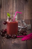 picture of cherries  - homemade cherries drink with fresh cherry on wooden table - JPG