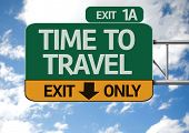 picture of time flies  - Time To Travel road sign with sky background - JPG