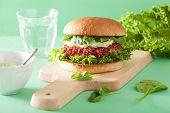 stock photo of beet  - vegan beet and quinoa burger with avocado dressing - JPG