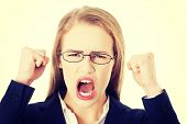 pic of shout  - Angry young blonde businesswoman shouting - JPG