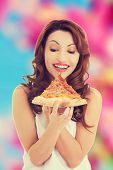 picture of take out pizza  - Happy beautiful woman eating pizza - JPG