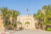 stock photo of fortified wall  - Old gate in defensive walls in Taroudant - JPG