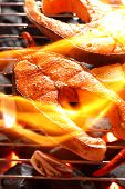 foto of salmon steak  - Salmon steak on the grill with flame - JPG