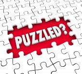 picture of confuse  - Puzzled word in 3d letters in a hole for missing pieces to illustrate a feeling of being lost - JPG