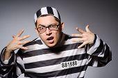 foto of prison uniform  - Funny prisoner isolated on gray - JPG
