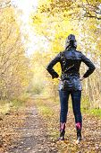 stock photo of woman boots  - woman wearing rubber boots in autumnal nature - JPG