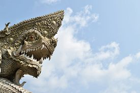 image of serpent  - Serpent or naga statue head with blue sky background - JPG