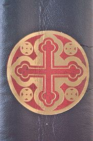 pic of celtic  - Red and gold decorative celtic cross engraved on the spine of an old leather book - JPG
