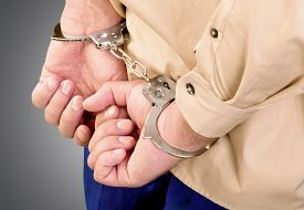 picture of handcuff  - Arrested man in handcuffs with hands behind back - JPG