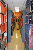 foto of shelving unit  - Shelving units in the stacks of a university or college library - JPG