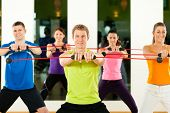Group of five people exercising with flexi bar to strengthen the intrinsic muscles in gym or fitness club