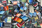 Choose mobile phone. Heap of the different smartphones with different application on the screen. Mod poster