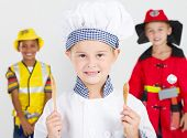 happy little chef in front of construction worker and fireman