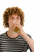 portrait of a young boy who is drinking beer
