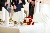 pic of wedding feast  - Wedding table at a wedding feast decorated with flowers - JPG